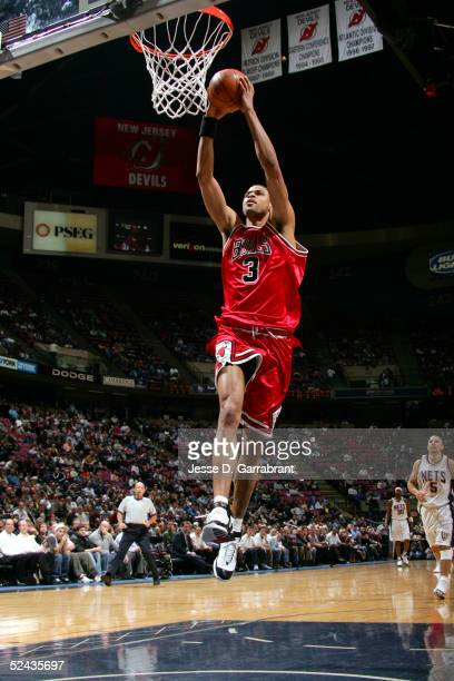 Tyson Chandler of the Chicago Bulls drives to the hoop against the New Jersey Nets on March 16 2005 at the Continental Airlines Arena in East...