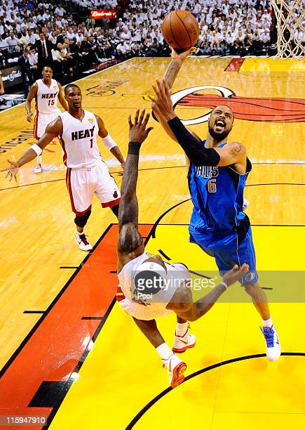 Tyson Chandler of the Dallas Mavericks attempts a shot against LeBron James of the Miami Heat in Game Six of the 2011 NBA Finals at American Airlines...