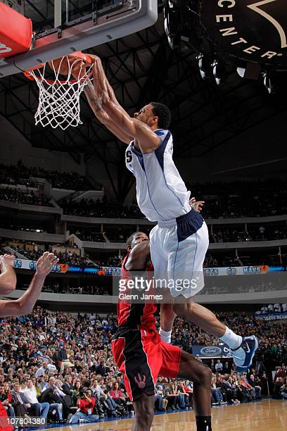 Tyson Chandler of the Dallas Mavericks dunks against Amir Johnson of the Toronto Raptors during a game on December 28 2010 at the American Airlines...