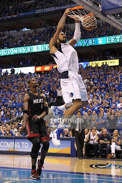 Tyson Chandler of the Dallas Mavericks dunks against Chris Bosh of the Miami Heat in the second half of Game Five of the 2011 NBA Finals at American...