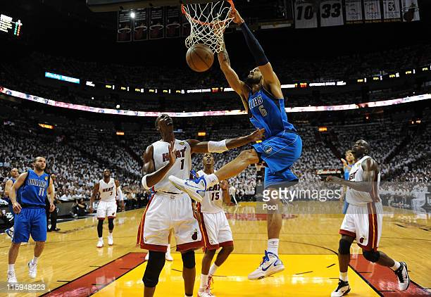 Tyson Chandler of the Dallas Mavericks dunks against Chris Bosh of the Miami Heat in Game Six of the 2011 NBA Finals at American Airlines Arena on...