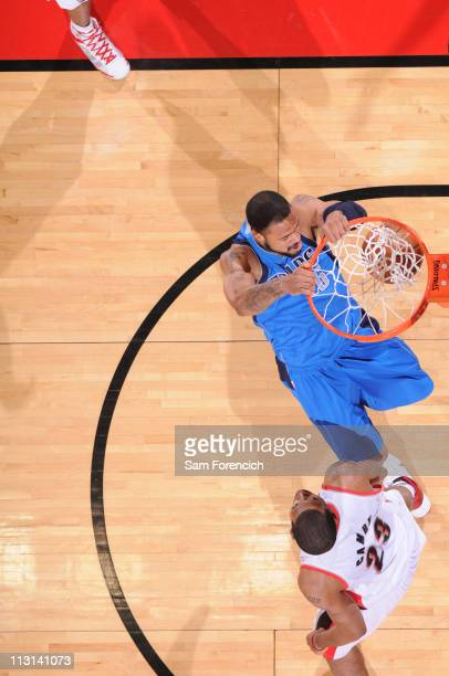 Tyson Chandler of the Dallas Mavericks dunks over Marcus Camby of the Portland Trail Blazers in Game Four of the Western Conference Quarterfinals in...