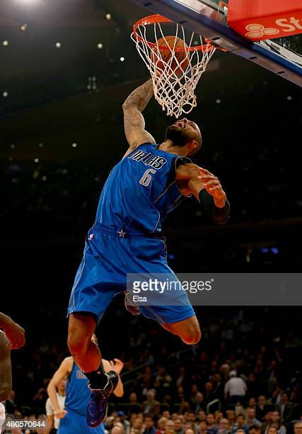 Tyson Chandler of the Dallas Mavericks dunks the ball in the first quarter against the New York Knicks at Madison Square Garden on December 16 2014...
