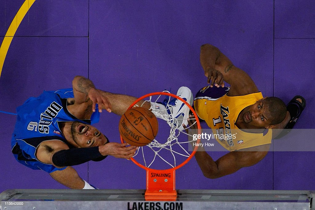 Tyson Chandler #6 of the Dallas Mavericks dunks the ball over his head as Ron Artest #15 of the Los Angeles Lakers looks on in the first quarter of Game One of the Western Conference Semifinals in the 2011 NBA Playoffs at Staples Center on May 2, 2011 in Los Angeles, California.