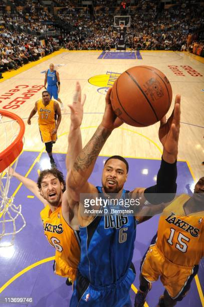 Tyson Chandler of the Dallas Mavericks goes to the hoop between Pau Gasol and Ron Artest of the Los Angeles Lakers in Game Two of the Western...
