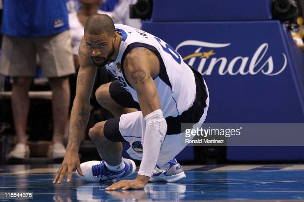Tyson Chandler of the Dallas Mavericks picks himself up off the court against the Miami Heat in Game Four of the 2011 NBA Finals at American Airlines...