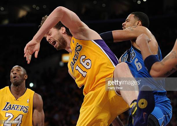Tyson Chandler of the Dallas Mavericks pushes Pau Gasol of the Los Angeles Lakers from behind and Chandler is called for a technical foul in in the...