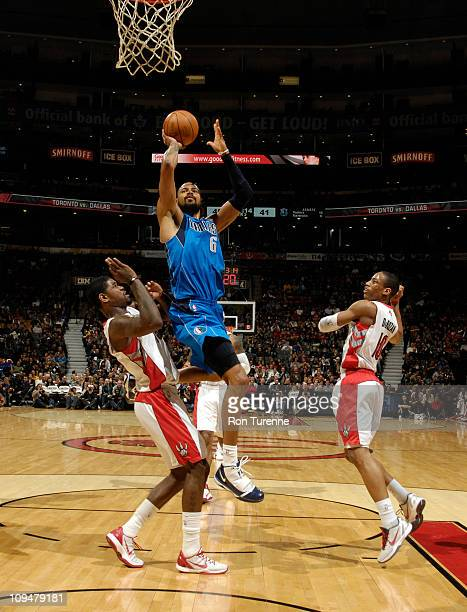 Tyson Chandler of the Dallas Mavericks shoots against Amir Johnson of the Toronto Raptors during the game on February 27 2011 at the Air Canada...