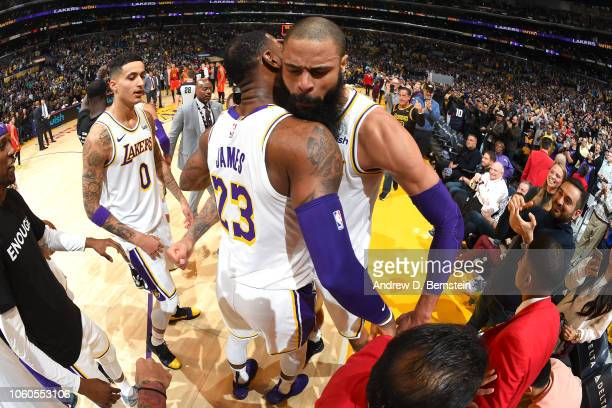 Tyson Chandler of the Los Angeles Lakers celebrates to a Laker's win with LeBron James of the Los Angeles Lakers after the game against the Atlanta...