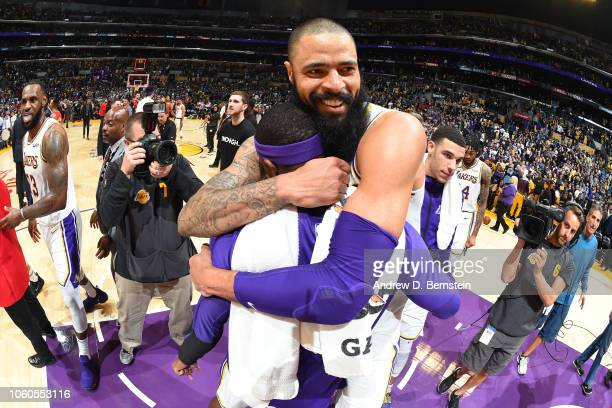 Tyson Chandler of the Los Angeles Lakers celebrates to a Laker's win with Rajon Rondo of the Los Angeles Lakers after the game against the Atlanta...