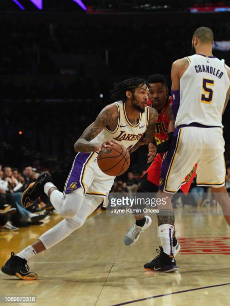 Tyson Chandler of the Los Angeles Lakers sets a screen on Kent Bazemore of the Atlanta Hawks as Brandon Ingram of the Los Angeles Lakers drives to...