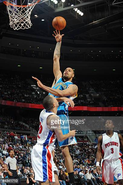 Tyson Chandler of the New Orleans Hornets attempts a shot over Tayshaun Prince of the Detroit Pistons in a game at the Palace of Auburn Hills on...