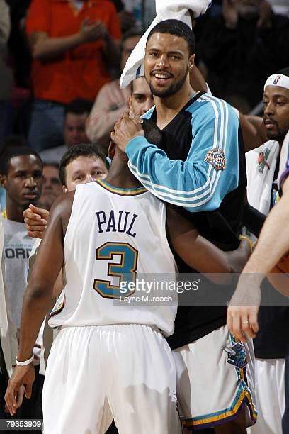 Tyson Chandler of the New Orleans Hornets congratulates teammate Chris Paul in the fourth quarter of their match against the Denver Nuggets on...