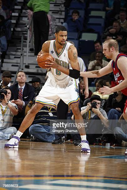 Tyson Chandler of the New Orleans Hornets looks to make a move against Chris Kaman of the Los Angeles Clippers during the game at the New Orleans...