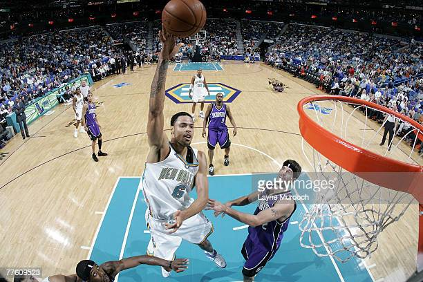 Tyson Chandler of the New Orleans Hornets shoots over Brad Miller of the Sacramento Kings on October 31 2007 at the New Orleans Arena in New Orleans...