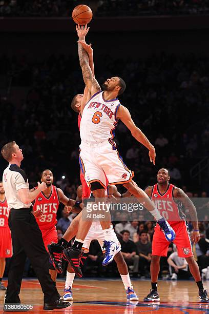 Tyson Chandler of the New York Knicks and Brook Lopez of the New Jersey Nets jump for the ball during their pre season game at Madison Square Garden...