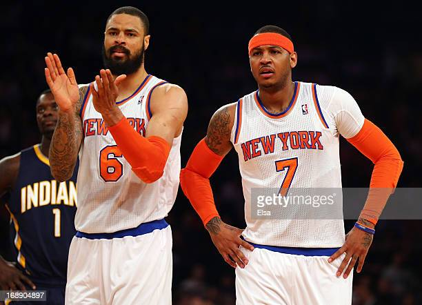 Tyson Chandler of the New York Knicks and Carmelo Anthony react after a play against Indiana Pacers during Game Five of the Eastern Conference...