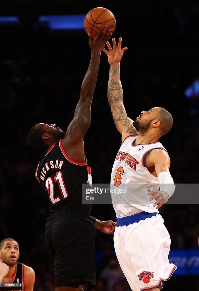 Tyson Chandler #6 of the New York Knicks and J.J. Hickson #21 of the Portland Trail Blazers fight for the tipoff on January 1, 2013 at Madison Square Garden in New York City.