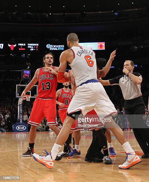 Tyson Chandler of the New York Knicks and Joakim Noah of the Chicago Bulls tussle and get ejected for fighting at Madison Square Garden on December...