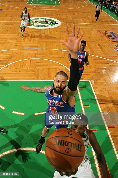 Tyson Chandler of the New York Knicks attemts to block a shot against the Boston Celtics in Game Four of the Eastern Conference Quarterfinals during...
