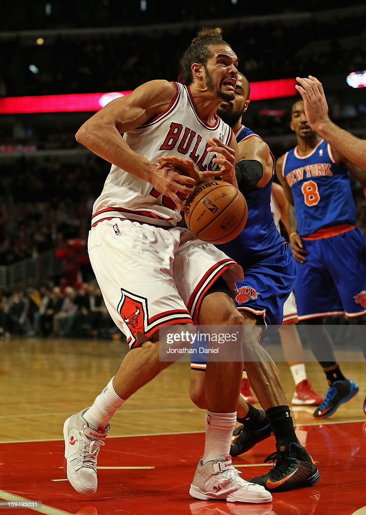 Tyson Chandler #6 of the New York Knicks knocks the ball away from Joakim Noah #13 of the Chicago Bulls at the United Center on December 8, 2012 in Chicago, Illinois. The Bulls defeated the Knicks 93-85.