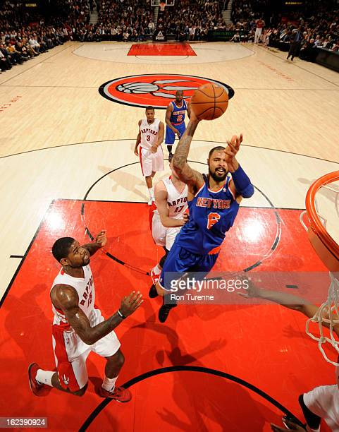 Tyson Chandler of the New York Knicks shoots against Amir Johnson of the Toronto Raptors on February 22 2013 at the Air Canada Centre in Toronto...