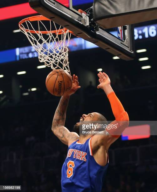 Tyson Chandler of the New York Knicks sinks a first quarter basket against the Brooklyn Nets at the Barclays Center on November 26, 2012 in the...