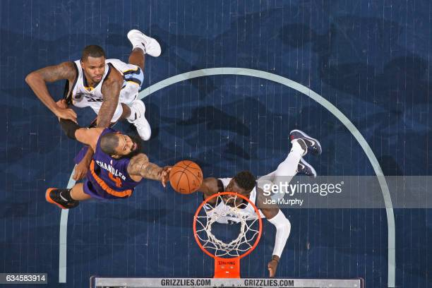 Tyson Chandler of the Phoenix Suns and James Ennis of the Memphis Grizzlies go up for a rebound on February 8 2017 at FedExForum in Memphis Tennessee...