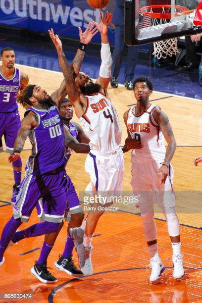 Tyson Chandler of the Phoenix Suns and Willie CauleyStein of the Sacramento Kings jump for the rebound on October 23 2017 at Talking Stick Resort...