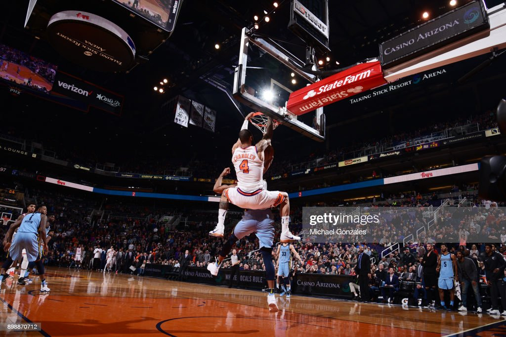 Tyson Chandler #4 of the Phoenix Suns makes the game-winning dunks against the Memphis Grizzlies on December 26, 2017 at Talking Stick Resort Arena in Phoenix, Arizona.