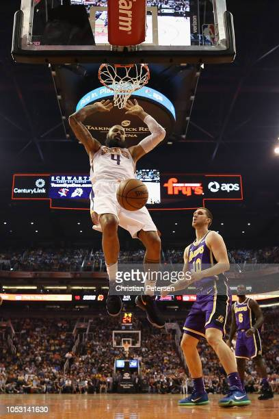 Tyson Chandler of the Phoenix Suns slam dunks the ball over Sviatoslav Mykhailiuk of the Los Angeles Lakers during the first half of the NBA game at...