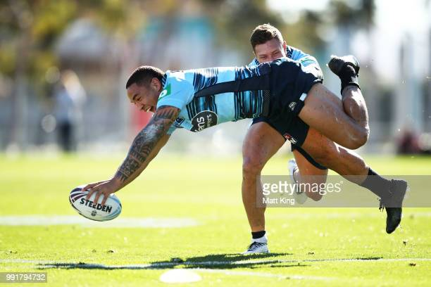 Tyson Frizell dives in front of Tariq Sims during a New South Wales Blues State of Origin training session at NSWRL Centre of Excellence Field on...