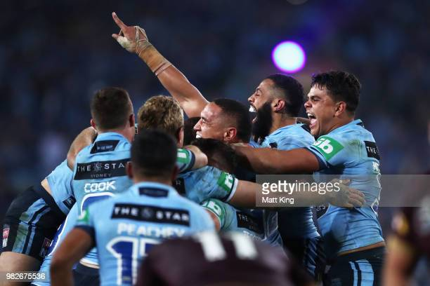 Tyson Frizell Josh AddoCarr and Latrell Mitchell of the Blues and team mates celebrate victory at the end of game two of the State of Origin series...