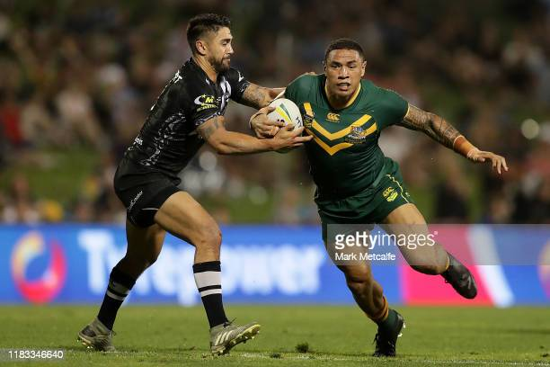 Tyson Frizell of Australia Is tackled by Shaun Johnson of New Zealand during the International Rugby League Test Match between the Australian...