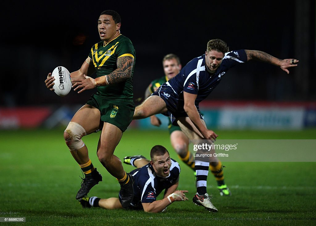 Tyson Frizell of Australia powers past Ben Hellewell and Euan Aitken of Scotland during the Four Nations match between the Australian Kangaroos and Scotland at KCOM Lightstream Stadium on October 28, 2016 in Hull, United Kingdom.
