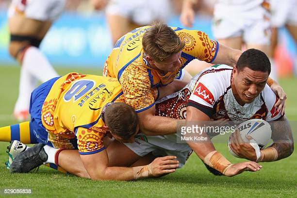 Tyson Frizell of Country is tackled by Aidan Sezer and Chris Lawrence of City during the NSW Origin match between City and Country at Scully Park on...