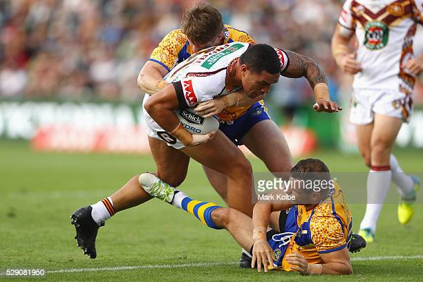 Tyson Frizell of Country is tackled by Chris Lawrence and Aidan Sezer of City during the NSW Origin match between City and Country at Scully Park on...