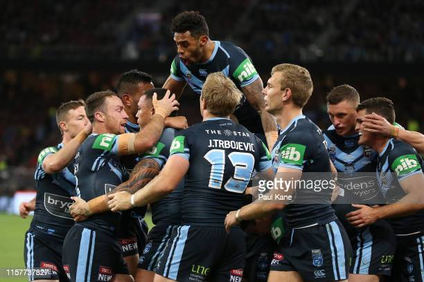 Tyson Frizell of New South Wales celebrates crossing for a try during game two of the 2019 State of Origin series between the New South Wales Blues...
