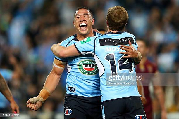 Tyson Frizell of the Blues celebrates scoring a try during game three of the State Of Origin series between the New South Wales Blues and the...