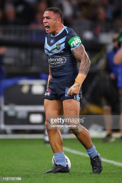 Tyson Frizell of the Blues scores a try during game two of the 2019 State of Origin series between the New South Wales Blues and the Queensland...