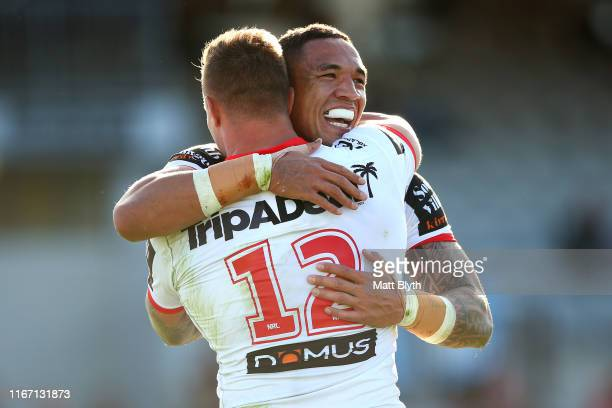 Tyson Frizell of the Dragons celebrates scoring a try with Tariq Sims of the Dragons during the round 21 NRL match between the St George Illawarra...
