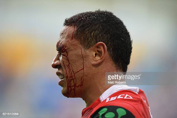 Tyson Frizell of the Dragons grimaces with blood on his face during the round seven NRL match between the Gold Coast Titans and the St George...