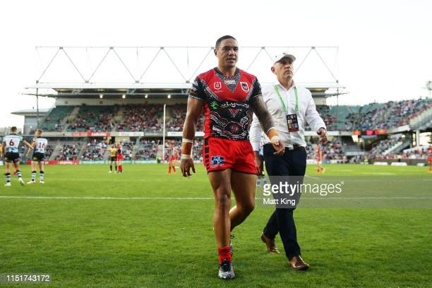 Tyson Frizell of the Dragons is assisted from the field after a head knock during the round 11 NRL match between the St George Illawarra Dragons and...