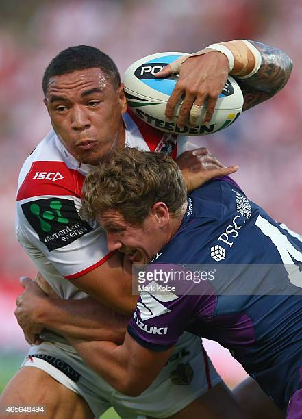 Tyson Frizell of the Dragons is tackled by Kurt Mann of the Storm during the round one NRL match between the St George Illawarra Dragons and the...