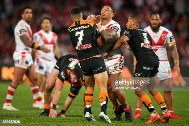 Tyson Frizell of the Dragons is tackled by Luke Brooks and Moses Mbye of the Tigers during the round 18 NRL match between the St George Illawarra...