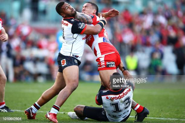 Tyson Frizell of the Dragons is tackled by Sam Lisone and Adam Blair of the Warriors during the round 21 NRL match between the St George Illawarra...