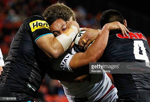 Tyson Frizell of the Dragons is tackled by the Panthers defence during the round 16 NRL match between the Penrith Panthers and the St George...