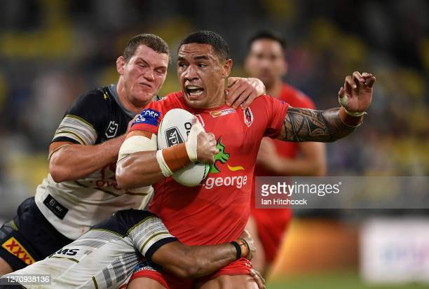 Tyson Frizell of the Dragons is tackled during the round 17 NRL match between the North Queensland Cowboys and the St George Illawarra Dragons at QCB...