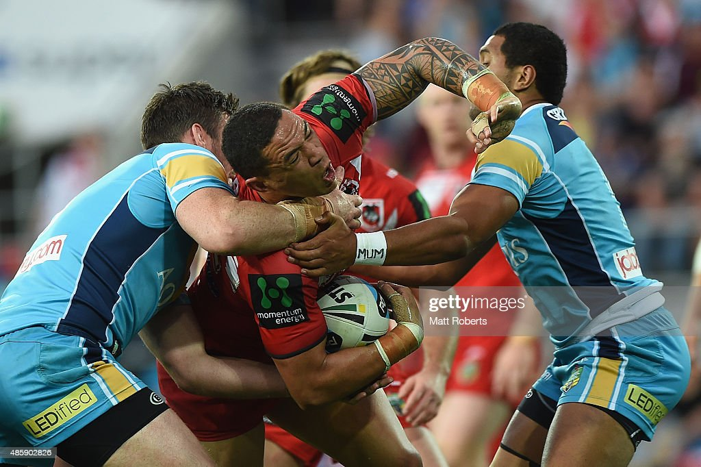 Tyson Frizell of the Dragons is tackled during the round 25 NRL match between the Gold Coast Titans and the St George Illawarra Dragons at Cbus Super Stadium on August 30, 2015 on the Gold Coast, Australia.