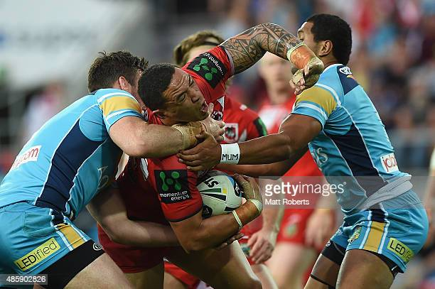 Tyson Frizell of the Dragons is tackled during the round 25 NRL match between the Gold Coast Titans and the St George Illawarra Dragons at Cbus Super...
